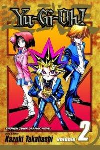 """Yu-Gi-Ohin toisen osan kansikuva. Kuvassa Yuugi Mutoun """"toinen persoonallisuus"""" (keskellä), Anzu Mazaki (vasemmalla) ja Katsuya Jounouchi (oikealla)."""
